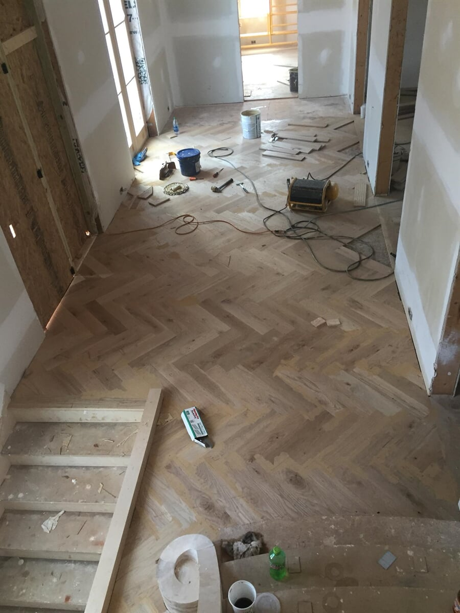Our herringbone hardwood installation in progress in Winder, GA