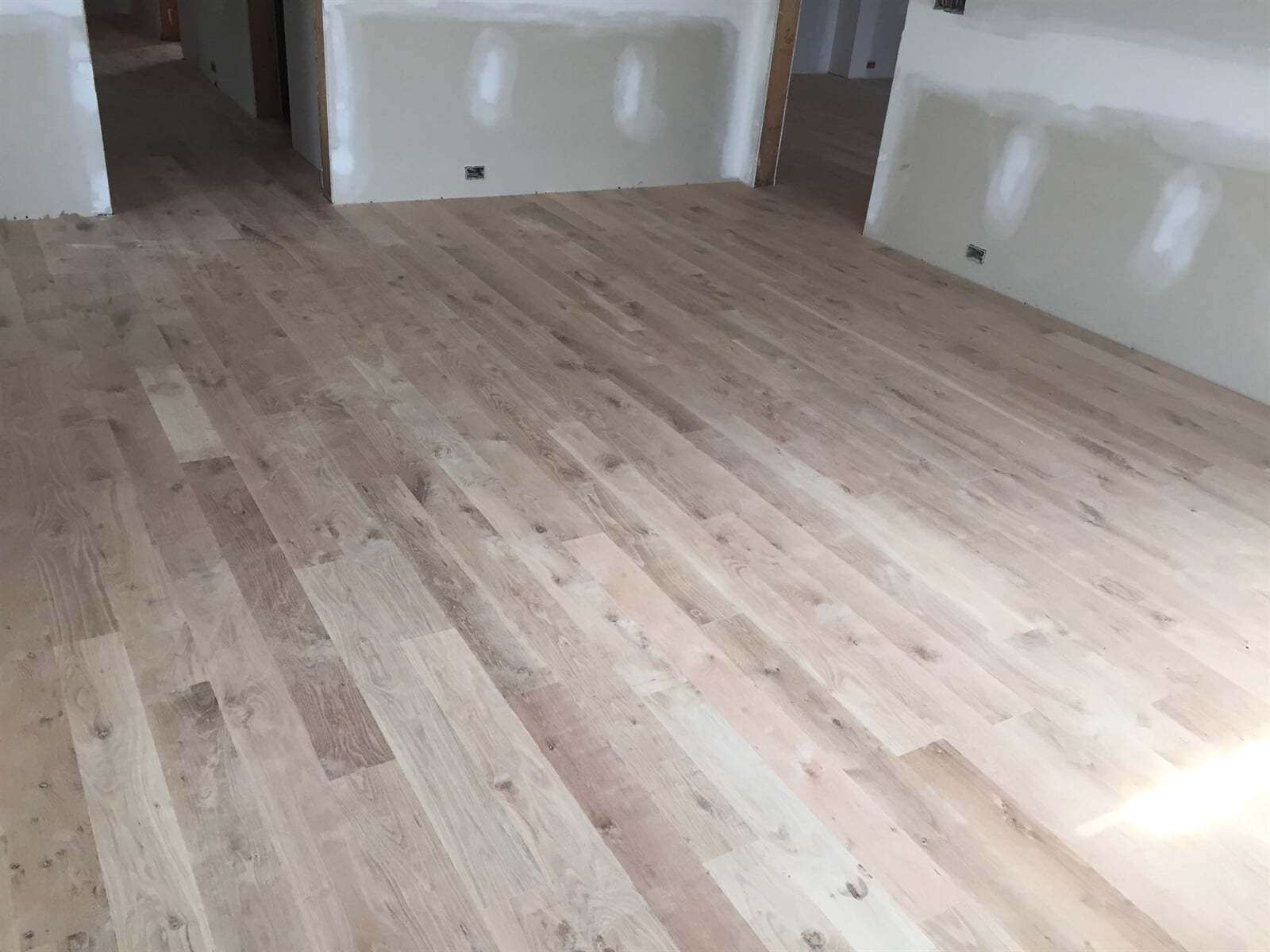 Thin hardwood plank installation in Watkinsville, GA from Carpets Unlimited