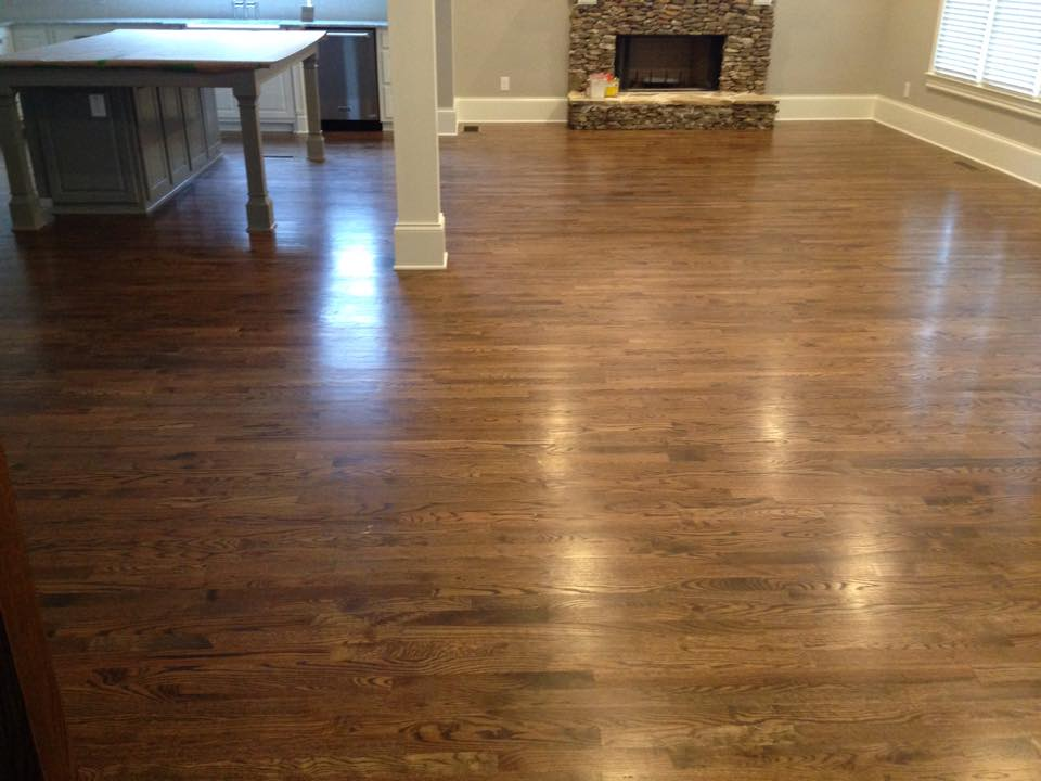 Smooth finish dark tone hardwood flooring in Watkinsville, GA