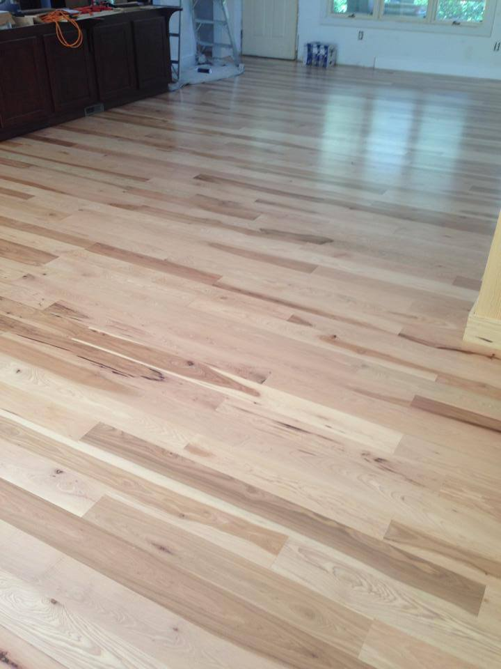 Smooth finish light color hardwood installation in Watkinsville, GA