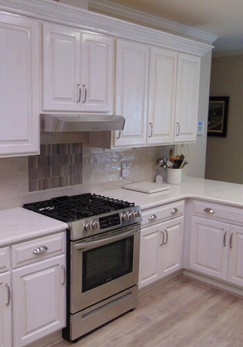 White cabinets and countertops in Elm City, NC from Richie Ballance Flooring & Tile