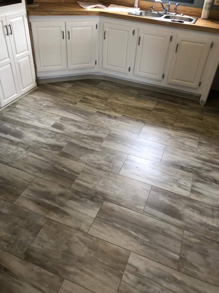 Wood look tile flooring in kitchen in Holgate, OH from Carpet Wholesalers