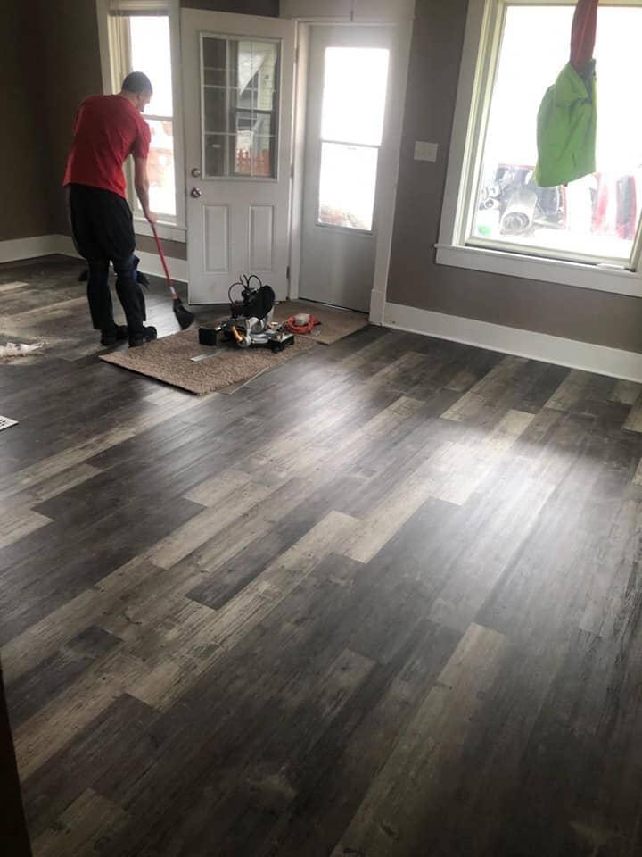 Finishing a beautiful wood look flooring installation in Napoleon, OH