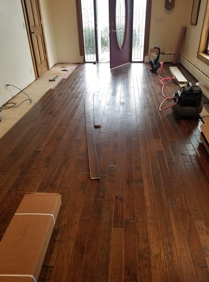 Narrow plank hardwood flooring installation in progress in Paulding, OH