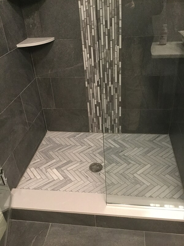 Glass tile accent and herringbone shower floors in Wethersfield, CT from Custom Floors
