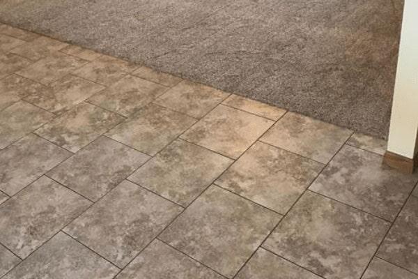 Tile to carpet flooring transition from Kluesner Flooring in Delhi, IA
