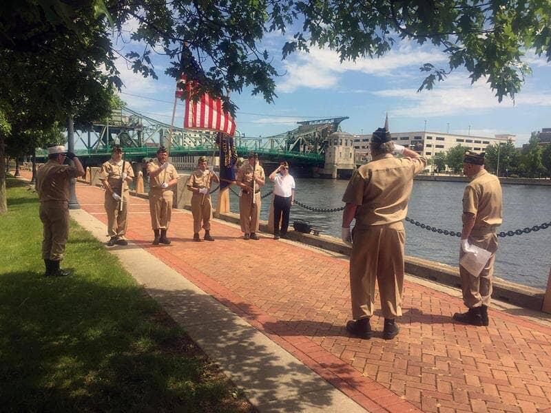 Veterans outside saluting