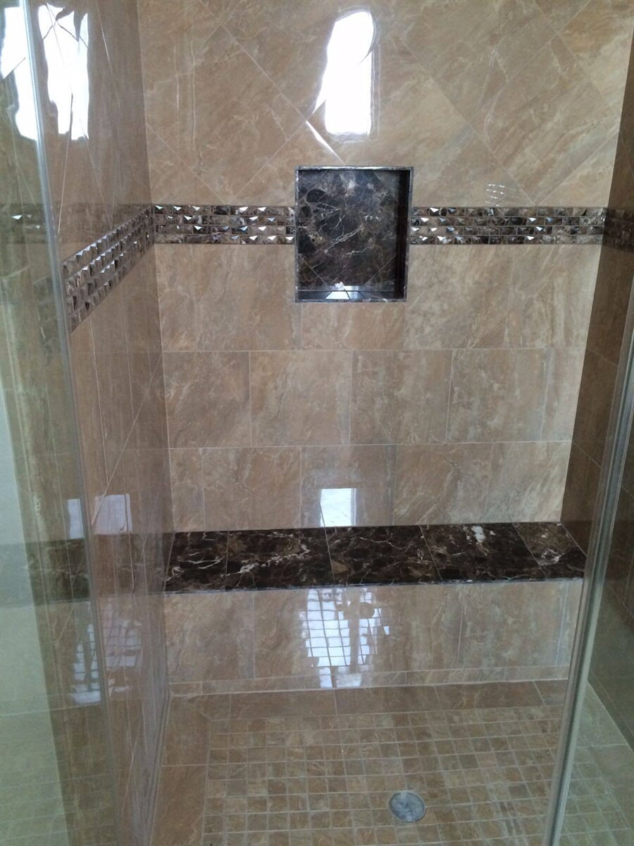Shower installation with glass tile accents from Century Flooring & Decor in Redlands, CA
