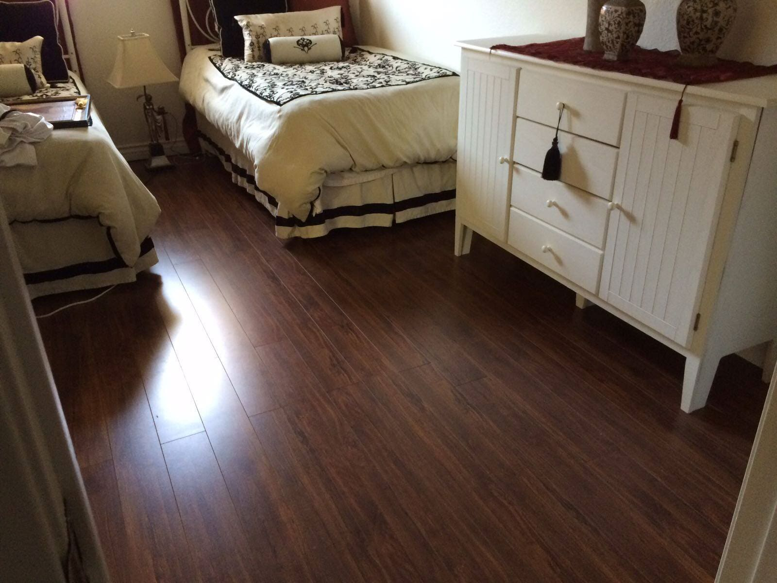 Dark hardwood bedroom floors from Century Flooring & Decor in Corona, CA