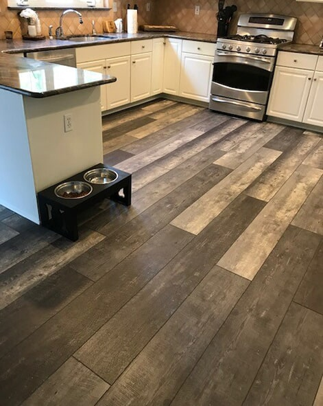 This gorgeous Vinyl plank flooring was used in a living room, dining room and kitchen remodel in Brick, NJ.