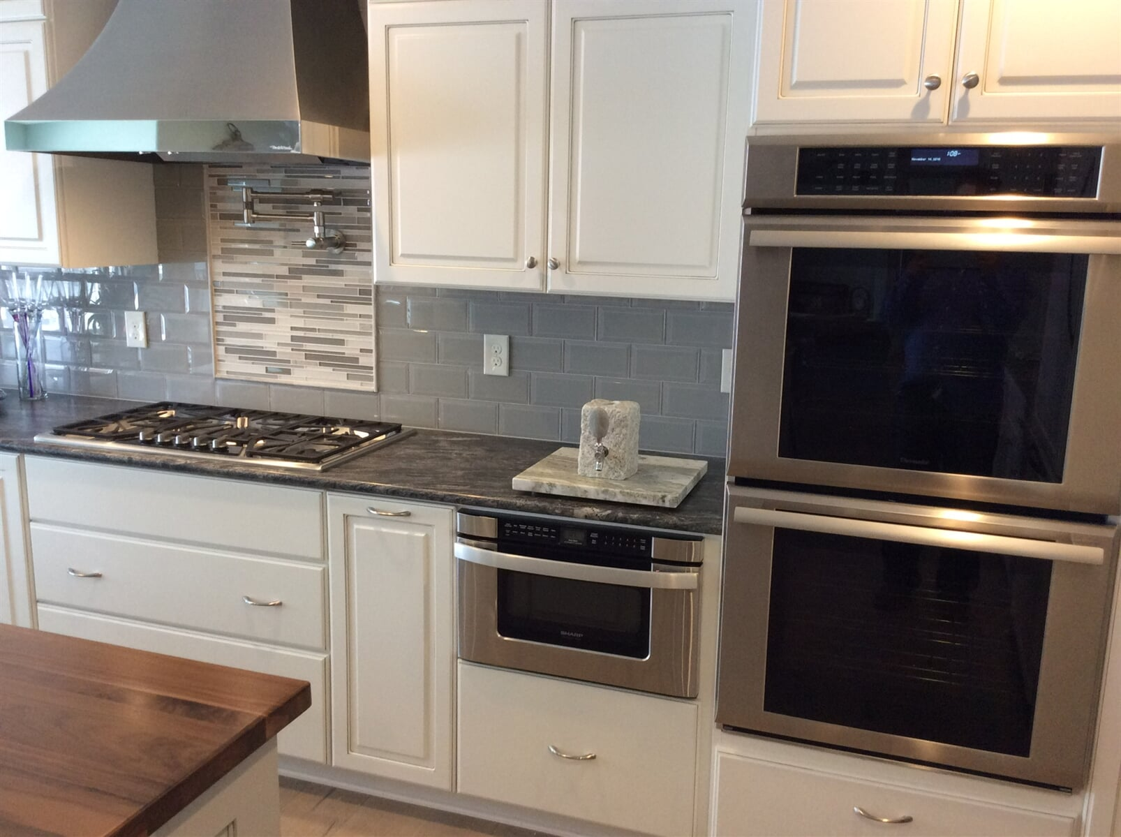 Custom glass tile backsplash piece in Franklin County, VA from The Floor Source