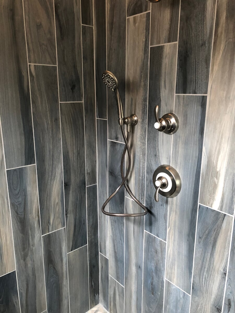 Wood look tile shower in New River Valley, VA from The Floor Source