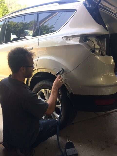 Employee Nick working on Rear Fender of SUV