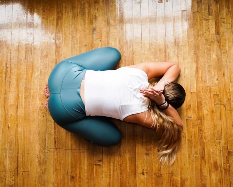 birds eye view of woman doing yoga on polished wood floor