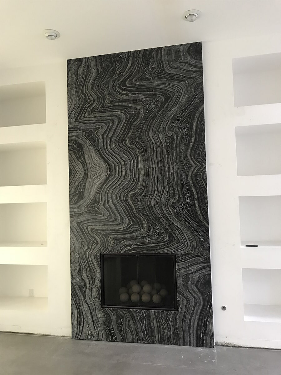 Stone fireplace surround in Summerlin, NV from GoPro Interiors
