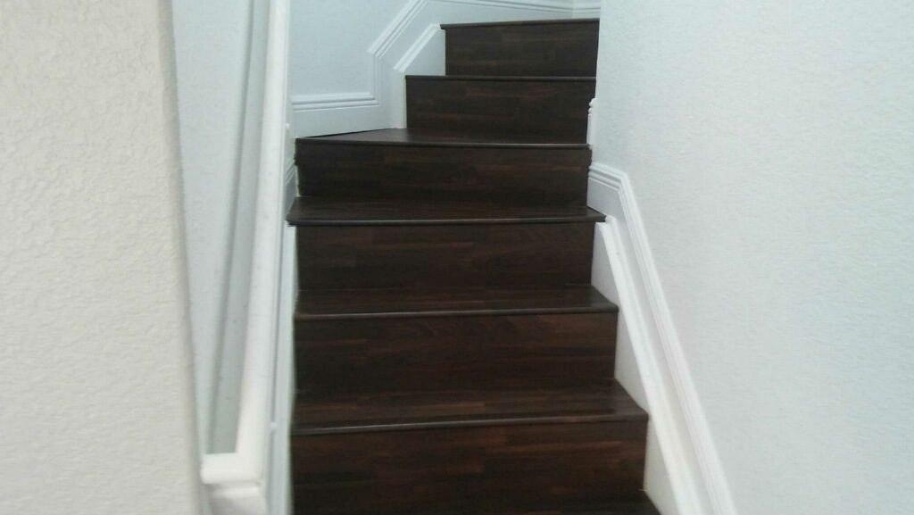 Dark wood-look laminate stairs in Dania Beach, FL from Daniel Flooring