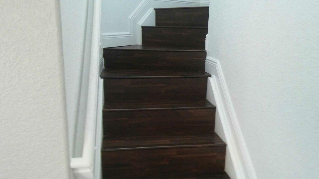 Dark wood-look laminate stairs in Dania Beach, FL from Daniel Flooring