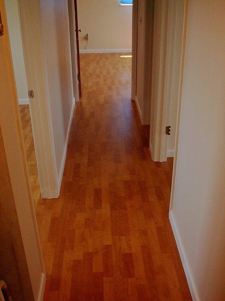 Modern laminate flooring in hallway in Fort Lauderdale, FL from Daniel Flooring
