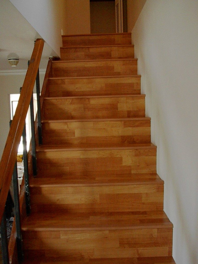 Classic hardwood look stairway with laminate in Plantation, FL from Daniel Flooring