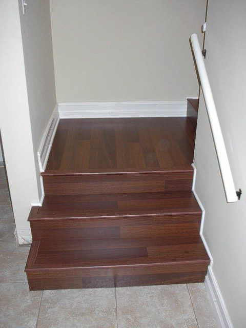 Red tone wood look laminate stairs in Fort Lauderdale, FL from Daniel Flooring