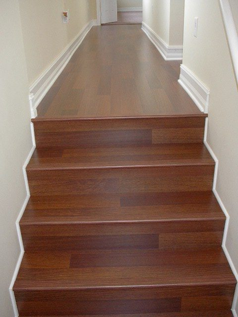 Laminate stair install with red tones in Hollywood, FL from Daniel Flooring