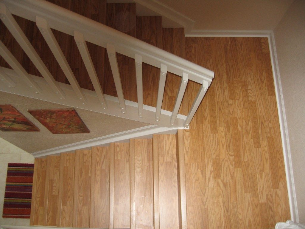 Wood-look laminate stairway in Dania Beach, FL from Daniel Flooring