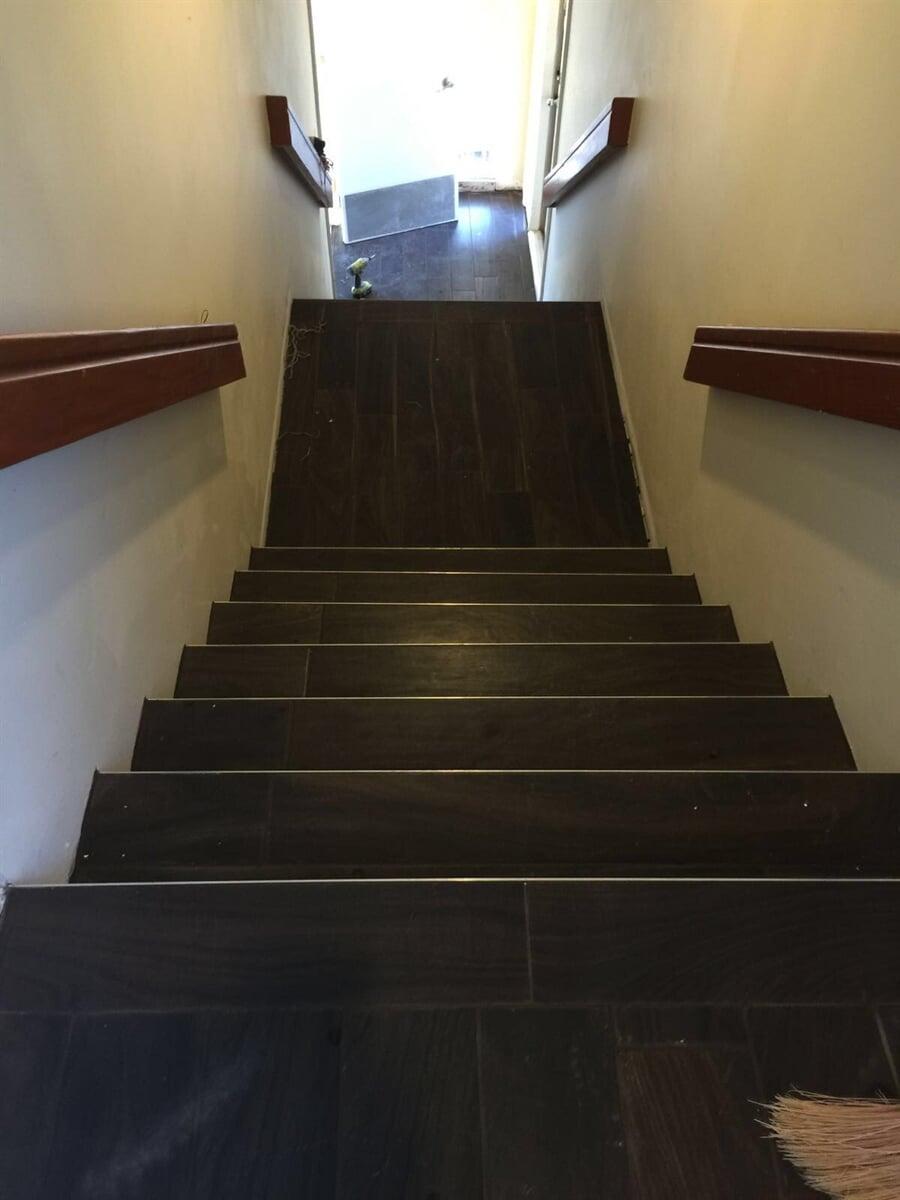 Dark tile stairway installation in Weston, FL from Daniel Flooring