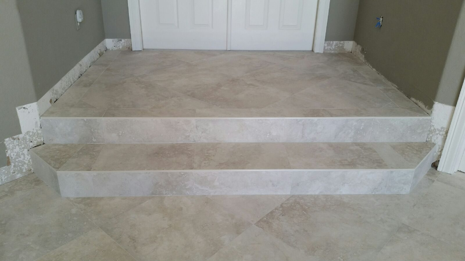 Tile stairs in multilevel home in Fort Lauderdale, FL from Daniel Flooring