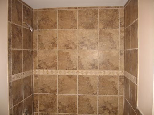 Tile shower with accent stripe in Dania Beach, FL from Daniel Flooring