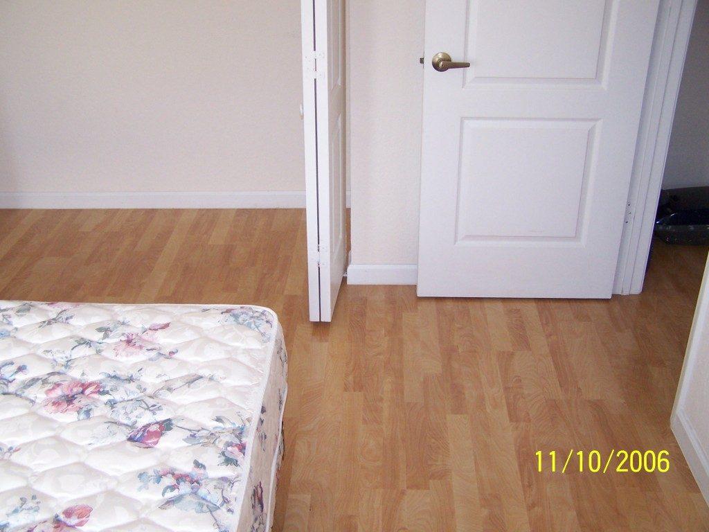 Classic tone hardwood in bedroom in Hollywood, FL from Daniel Flooring