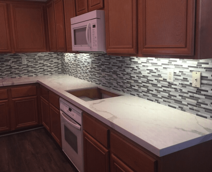 Clean glass tile backsplash in classic kitchen in Valencia, CA from Dave Walter Flooring Kitchens and Baths