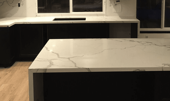 Natural stone island waterfall countertop from Dave Walter Flooring Kitchens and Baths