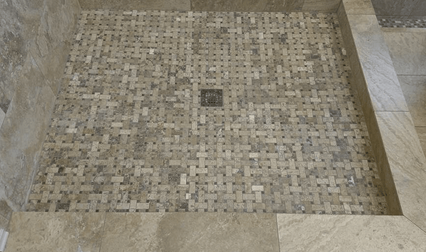Patterned tile shower floor in Santa Clarita, CA from Dave Walter Flooring Kitchens and Baths