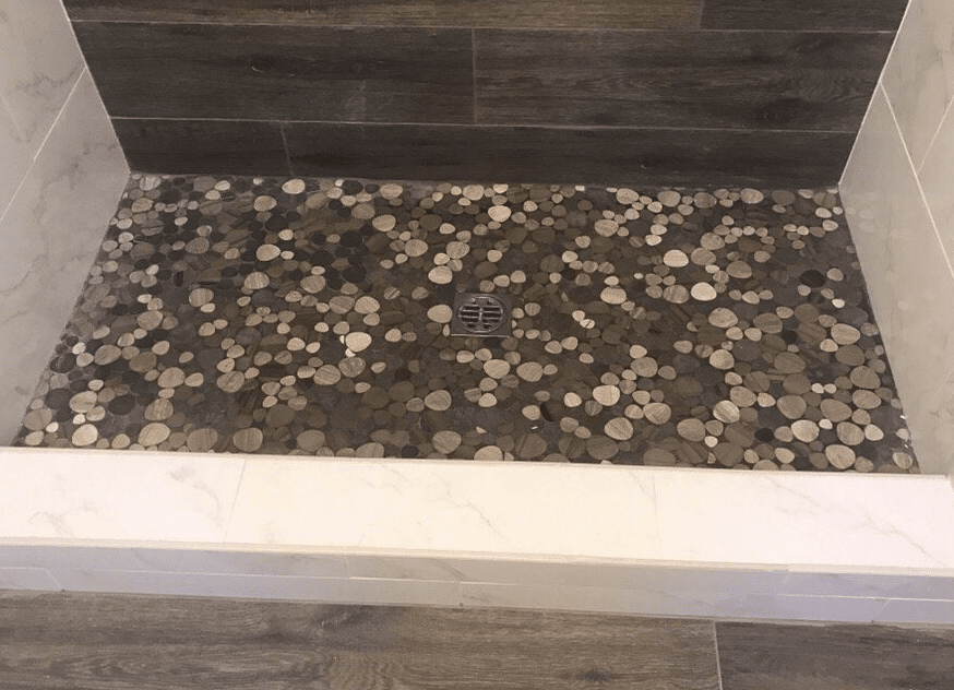 Custom round glass tiles on shower floor in Newhall, CA