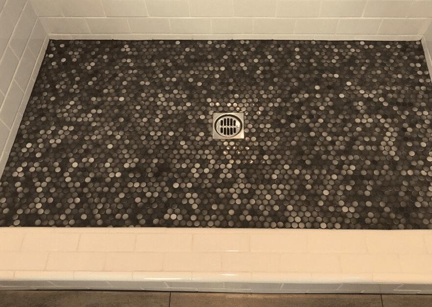 Custom hexagonal glass tile shower floor in Valencia, CA