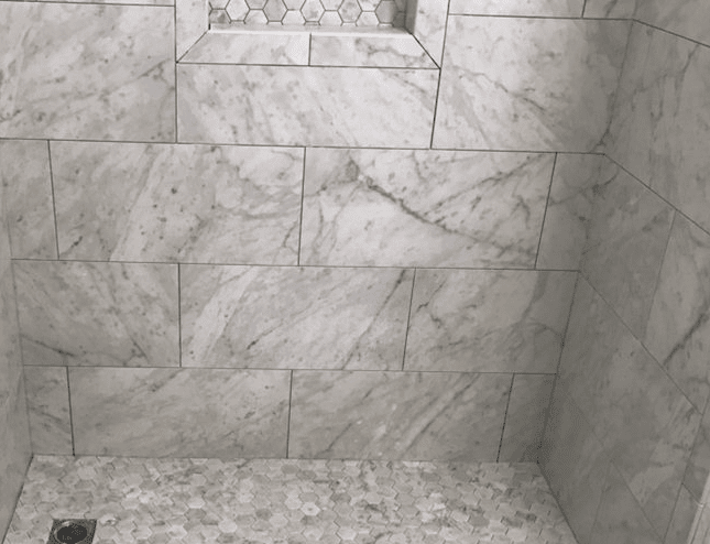 Gorgeous natural stone shower with hexagonal accents in Saugus, CA