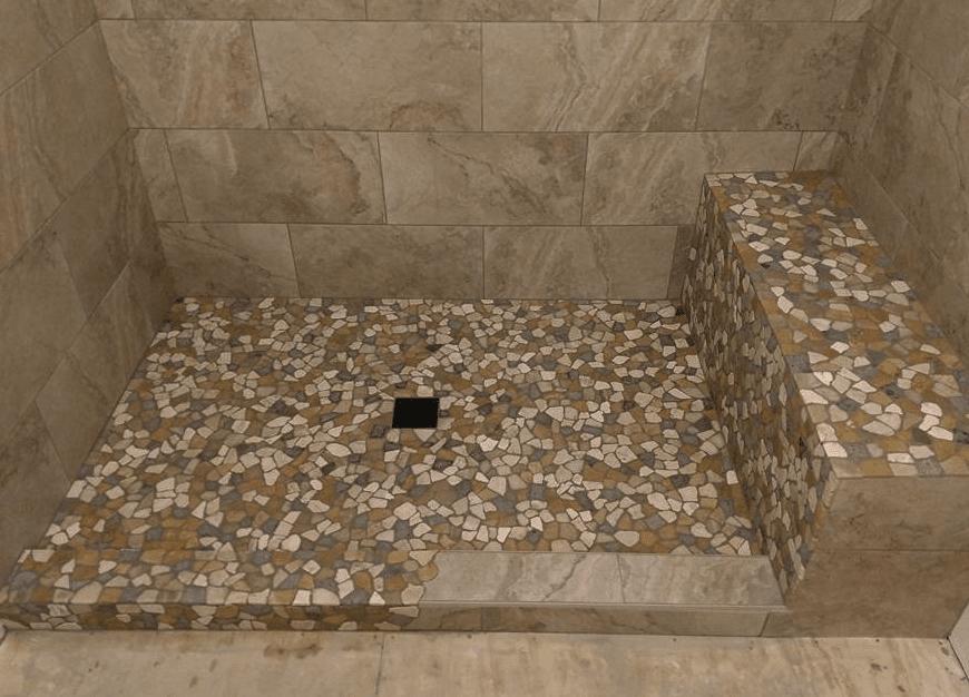 Custom natural shape floor tiles in shower in Castaic, CA