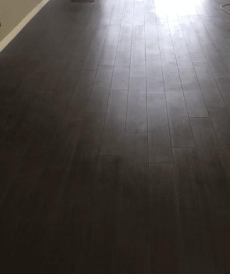 Beautiful dark tone flooring installation in Valencia, CA from Dave Walter Flooring Kitchens and Baths