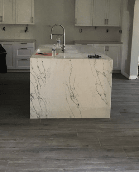 Modern island waterfall countertop in Valencia, CA from Dave Walter Flooring Kitchens and Baths