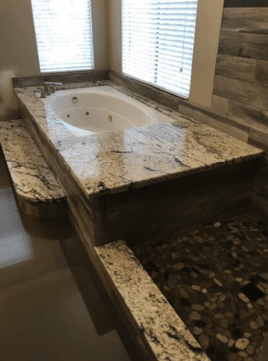 Intricate custom granite bath surround and shower installation in Castaic, CA