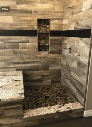 Stone tile shower renovation with black accents in Santa Clarita, CA