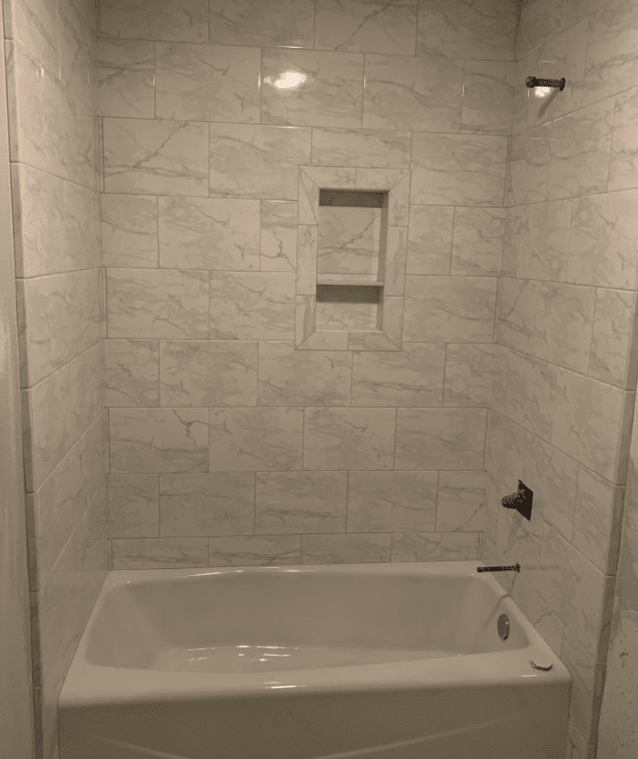 Clean white natural stone shower install in Santa Clarita, CA from Dave Walter Flooring Kitchens and Baths