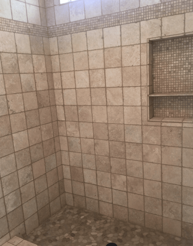 Classic tile shower with glass tile accents in Valencia, CA