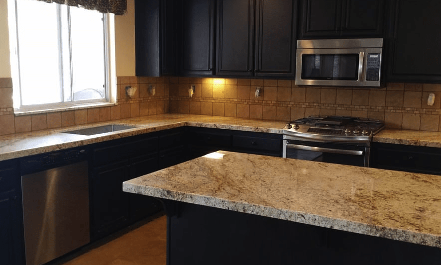 Classic kitchen remodel with dark tone cabinets and granite countertops in Saugus, CA