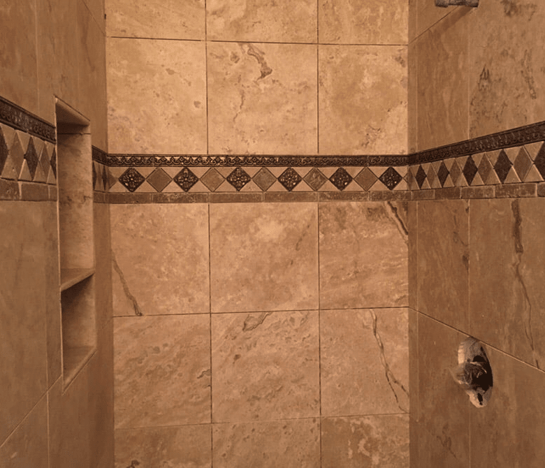 Intricate tile accent in shower in Saugus, CA from Dave Walter Flooring Kitchens and Baths