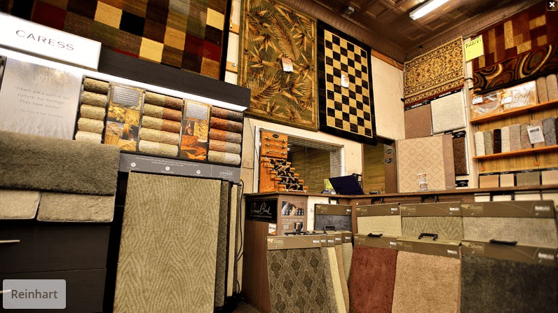 The walls at Reinhart Carpet Outlet covered with carpet samples and area rug options