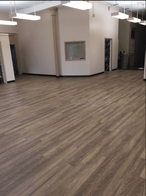 Luxury vinyl flooring installed in commercial space by Reinhart Carpet Outlet