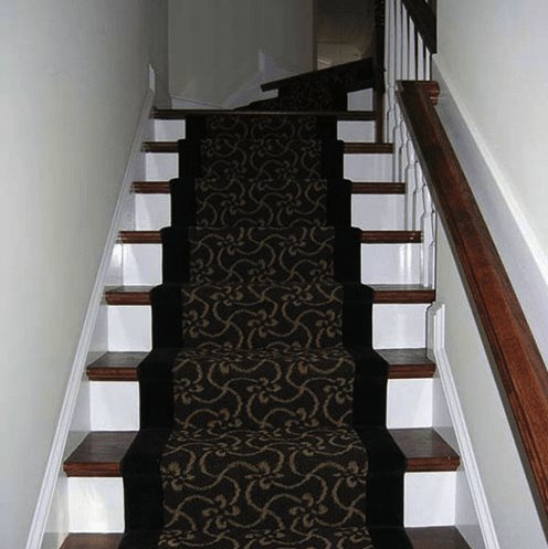 Stairs with ornate pattern carpet runner in Apex, NC from The Home Center Flooring & Lighting