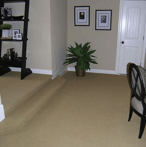 Multilevel home with carpeted stairs in Holly Springs, NC from The Home Center Flooring & Lighting
