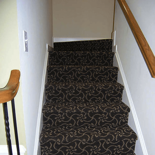 Patterned carpeted stairs in Raleigh, NC from The Home Center Flooring & Lighting